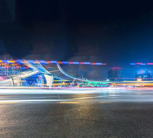 blurred-traffic-light-trails-road.jpg