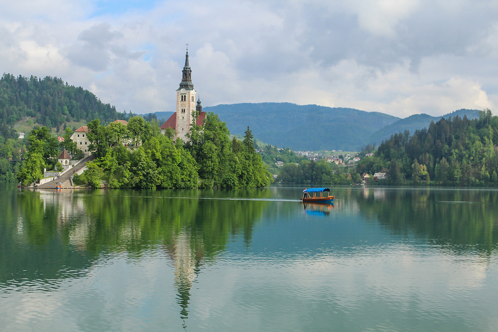 A boat heading to Bled Island and the 17th Baroque Church atop it