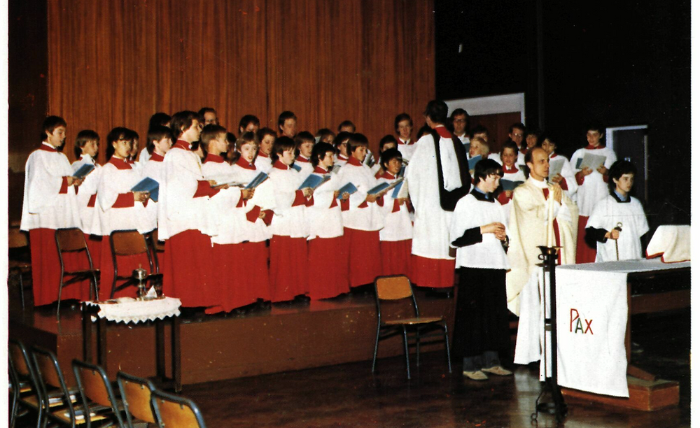 The Schola in 1980, singing for Mass at the School