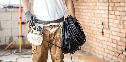 electrician-with-tools-working-construct