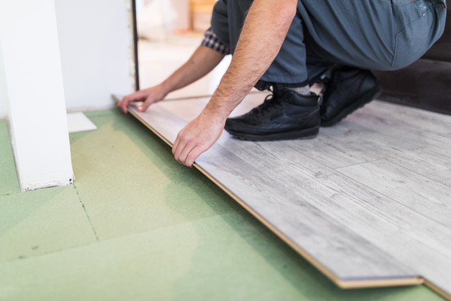 worker-processing-floor-with-laminated-f