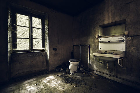bathroom-with-sink-wall-covered-dirt-lig