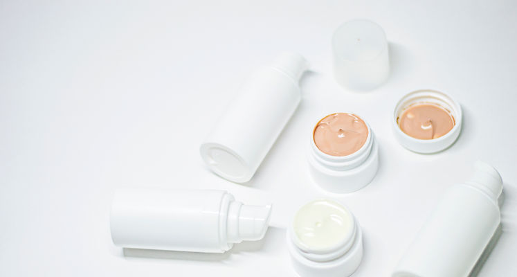 Minimal skincare products against a white background