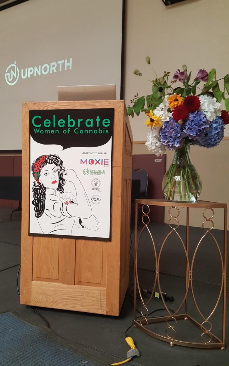 The Celebrate Women of Cannabis conference podium and stage, ready before the day begins.