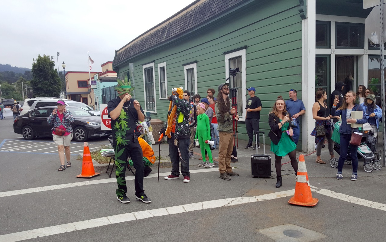 Founder of Humboldt Green, chamber member and the entity behind the parade, Stephen Gieder encourages the parade goers on the corner of 8th and G streets.