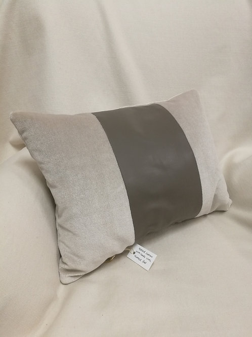 Light tan rectangular mohair cushion with a taupe vinyl band