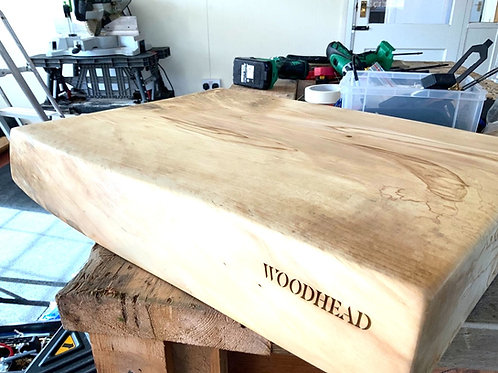 Solid thick chunks of wood chopping boards