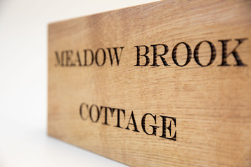 woodn house signs slanted