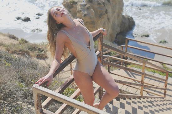 Shop One Piece Swimwear Low Plunge One Piece Swimsuit Nude