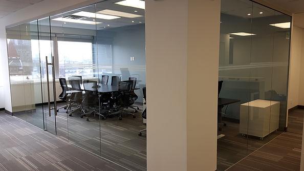Commercial boardroom with glass sliding door