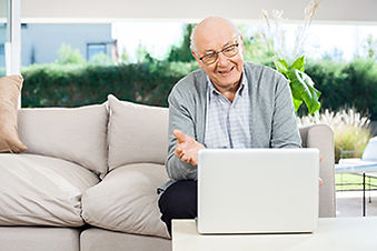 Man on Laptop Telehealth.jpg