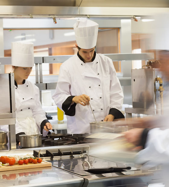Busy chefs at work in the restaurant kit