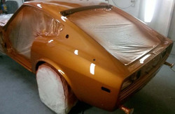 Greg has the first coat of clear on Carl's 280Z.  I think this car will turn out pretty nicely