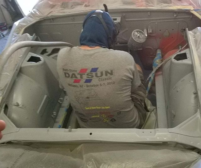 Greg shooting primer in Jim's Swiss 240Z engine bay... Ya, he really gets into his work
