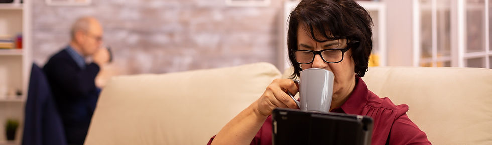 Elderly-woman-with-ipad-and-coffee-40746
