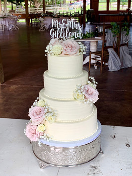 I am still hearing about how good our wedding cake was from guests and I doubt the compliments will ever stop coming... I am already looking forward to eating our top tier on our one year anniversary. Thank you for the perfect wedding cake, Rebekah! -Sierra G.