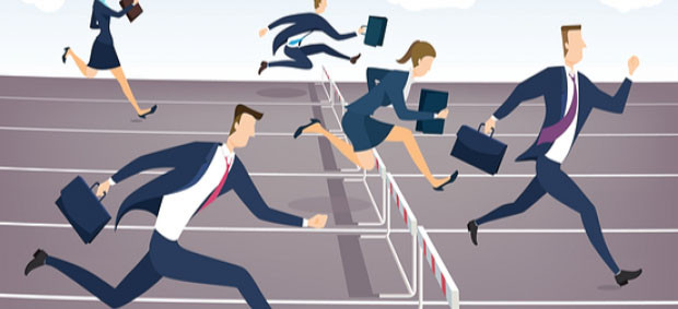 Business people jumping hurdles to win race