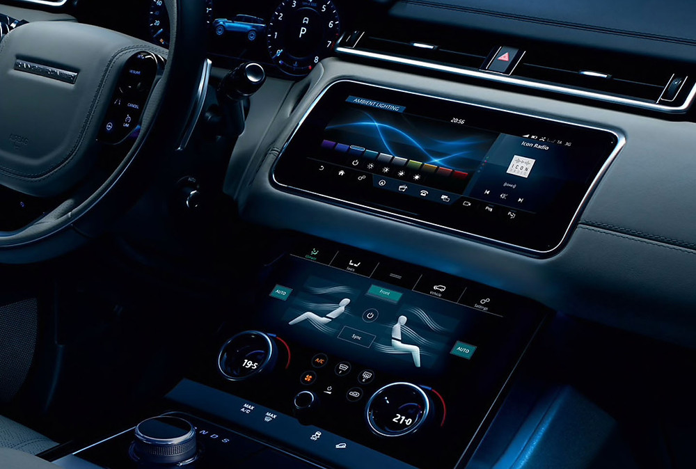 Cockpit of a Range Rover showing different screens and issues pertaining to each and priority