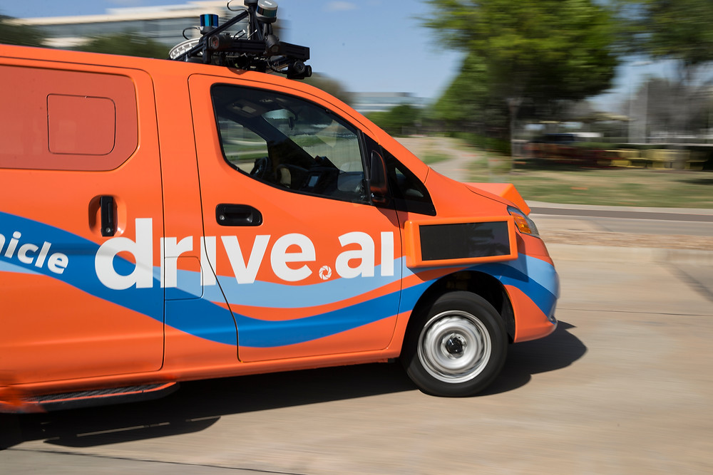 Drive.ai. Autonomous driving car caught from the side. No driver