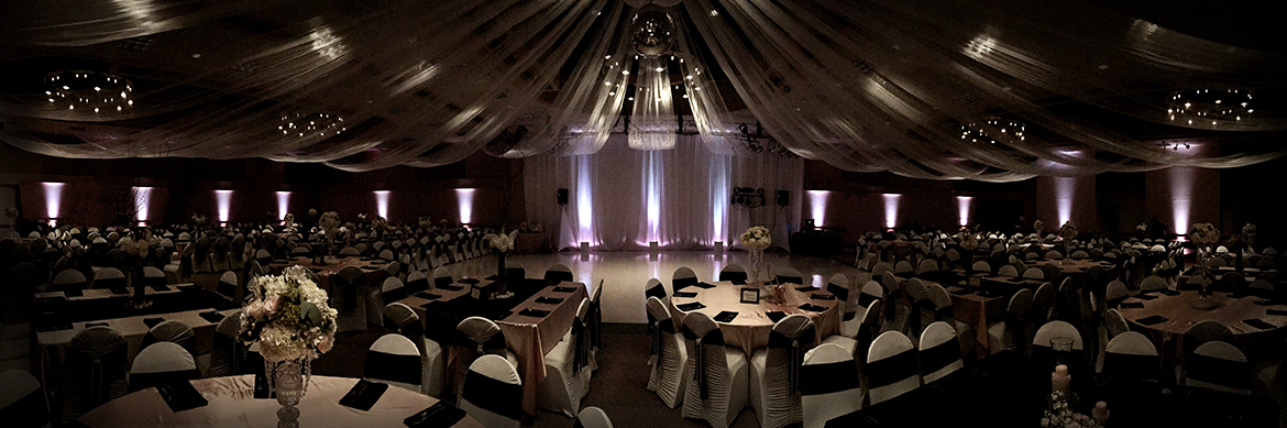 Dancin' Shoes DJ and Lighting - Ivory blush uplighting and drape - Sangre de Cristo Arts Center
