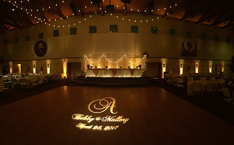 Dancin' Shoes DJ and Lighting - full room amber uplighting, monogram, twinkle lighting and headtable