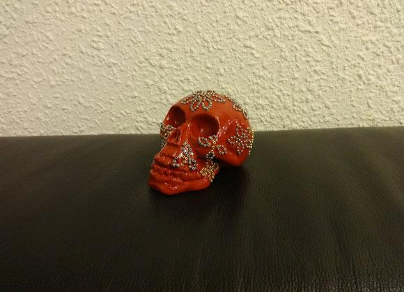Crâne céramique rouge perlé