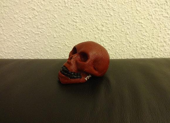Crâne céramique cuir rouge