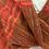 Thumbnail: Rust Tomato Harvest Twist Shawl