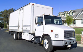 White Delivery truck.Gil's Wholesale.