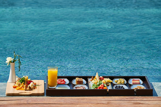 tray-of-food-beside-body-of-water-282828