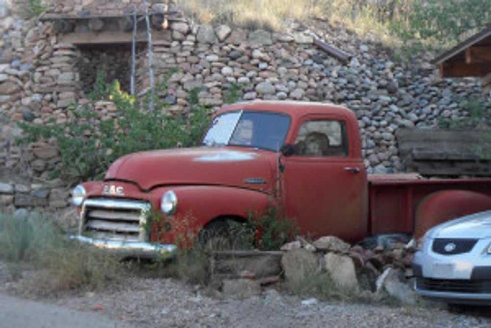 Old Truck and Shrine by the side of the road