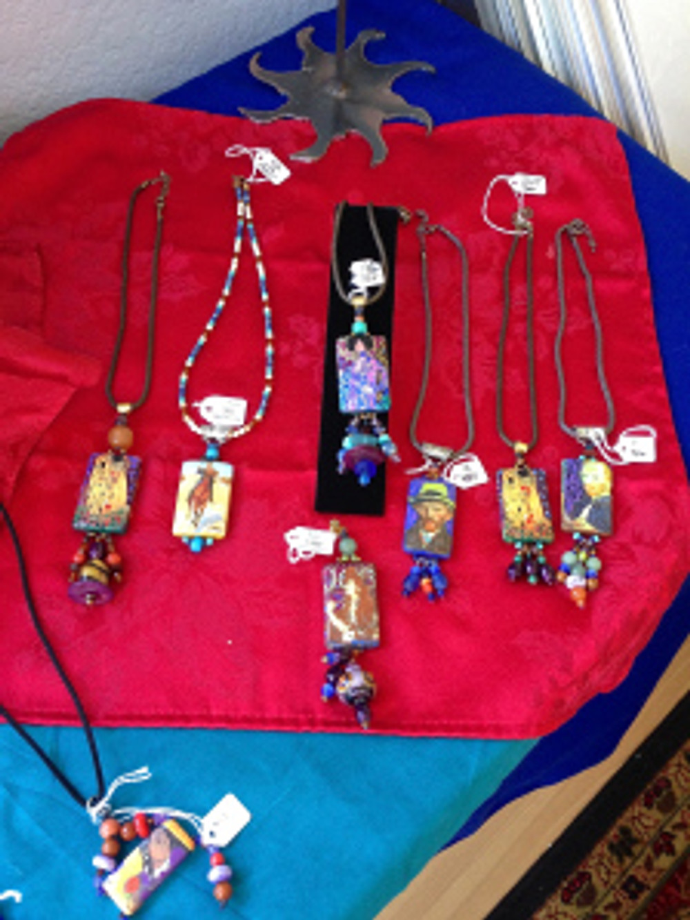 Art Pendants by Cathy Carey - made from hand painting collaged pieces of paintings by famous artists