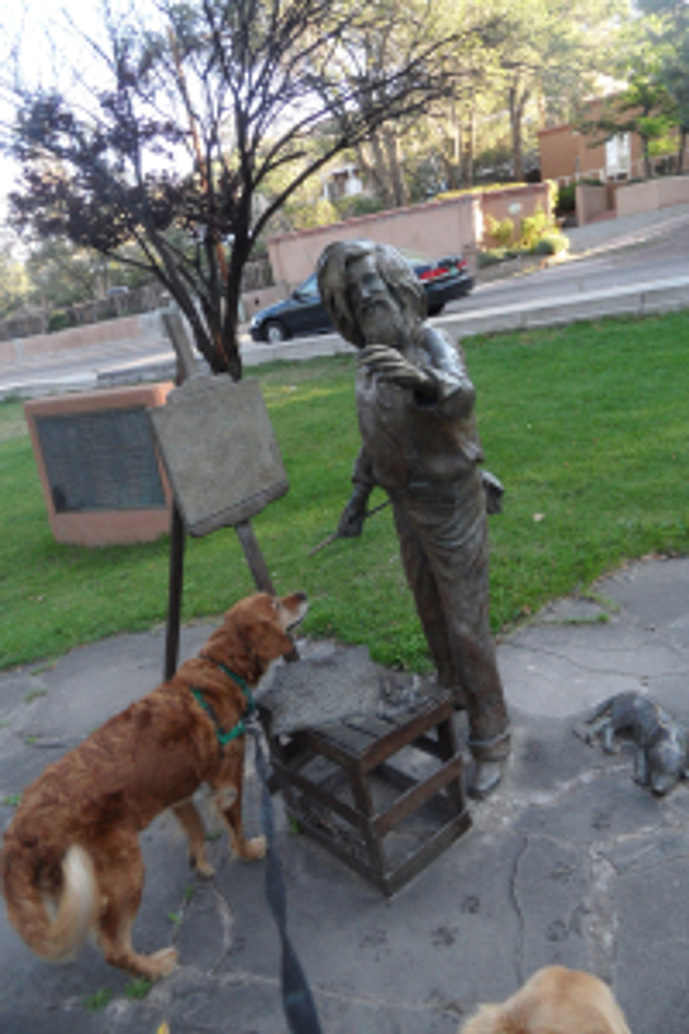 The art lover - Kira ran up tot this statue ina park near the house!