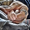 a-grandfather-holds-his-grandsons-hand-f