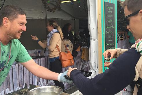 Ken Rowe shucks oysters at Tasting Australia Kangaroo Island stall