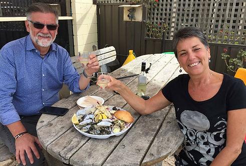 Oyster lovers enjoying a half farm shop share platter