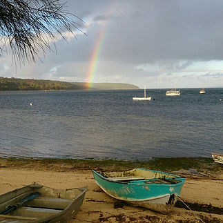 View of rainbow over Eastern cove taken from American River Kangaroo Island