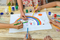 Canva - Children Hands Painting a Rainbo
