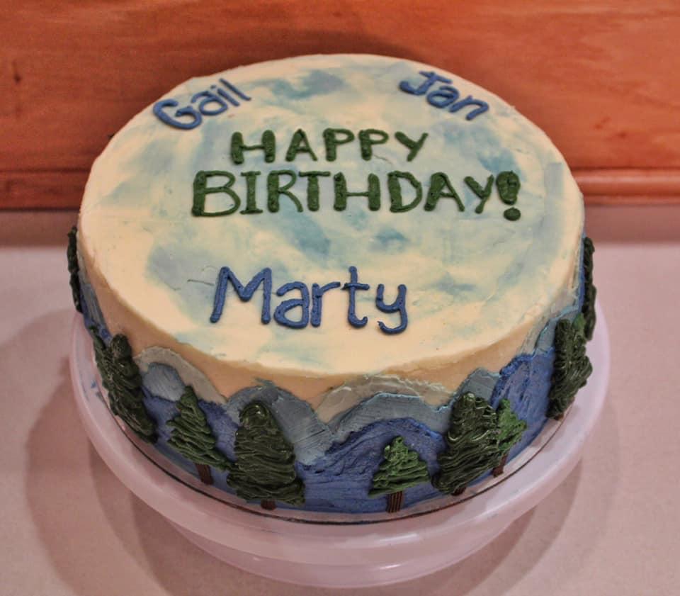 Outdoor themed multiple birthday cak