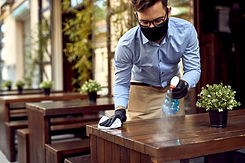 Waiter wearing protective face mask whil