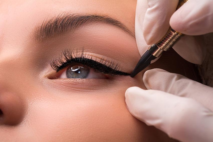 Permanent eye makeup close up shot. Cosm