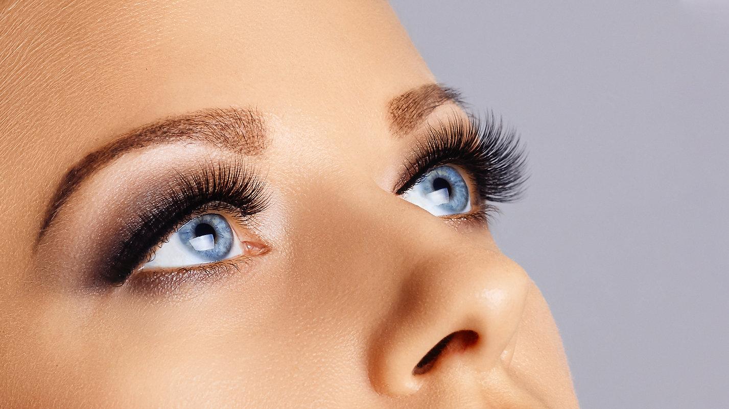 Woman eyes with long eyelashes and smoke