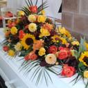 Kistepynt orange gule roser solsikker