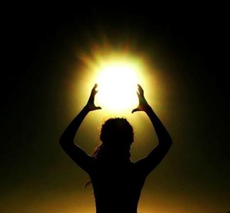 A women holding a bright ball of light