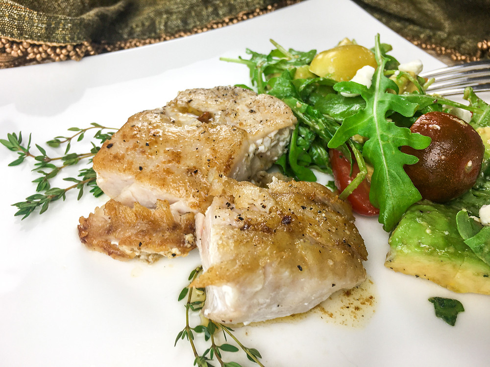 This is a cover image for a recipe for Seared Grouper with Lemon-Thyme Butter Sauce from Eats and Journeys