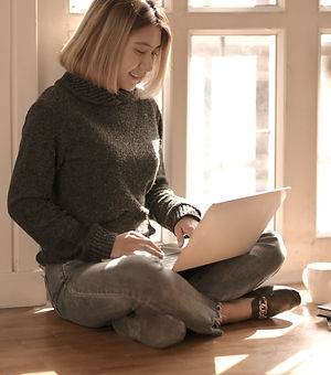 woman-in-gray-sweater-sitting-on-wooden-floor-typing-on-3759115_edited.jpg