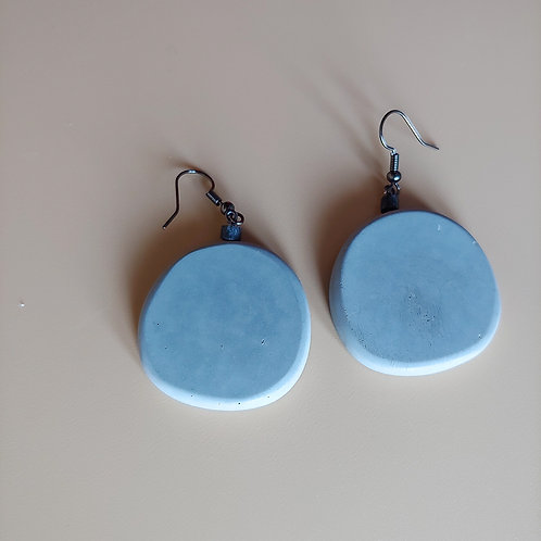cement round earrings: black bead