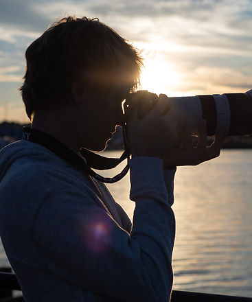 Photographer Luke Losee looks out on the Saginaw River in Bay City and takes photo of a drawbridge at Sunset