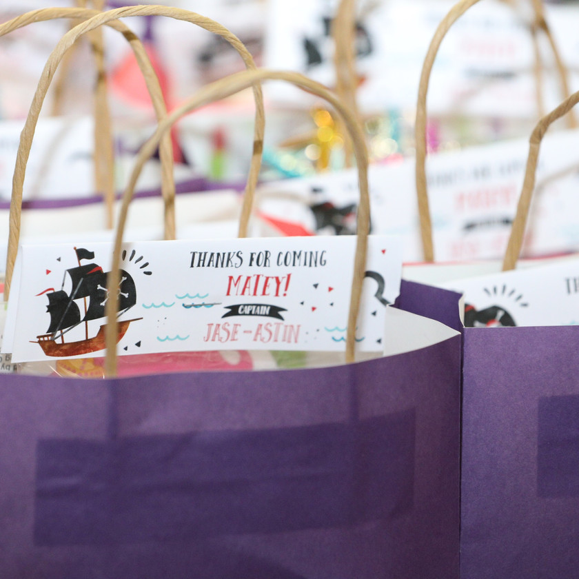 close up photo of purple gift bags at children's party