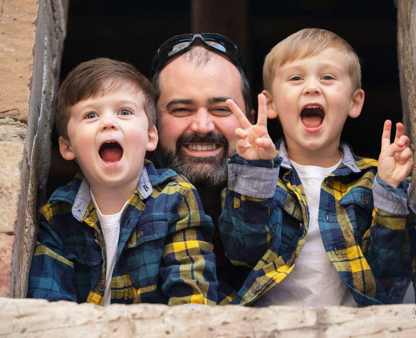 2 boys with their father